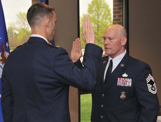 Major Marcus Corbett, commander of the Air Force Reserves 310th Security Forces Squadron, left, reads the oath of enlistment to Ray Birch on May 1 at Schriever Air Force Base in Colorado Springs. Birch, Routt County's undersheriff, was promoted to Chief Master Sergeant, the highest rank an enlisted soldier can receive.
