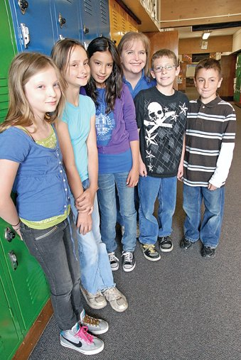 From left, Madison Meckley, Dajia Lewis, Lizbeth Magallanes, Brycie Klein, Josh Worster and Tristan Farquharson gather outside Klein's classroom at Sandrock Elementary School. The five students were nominated by their teacher to attend the Junior National Young Leaders Conference this fall in Washington, D.C. The conference is an educational program designed for students who demonstrate leadership potential, maturity and academic excellence.
