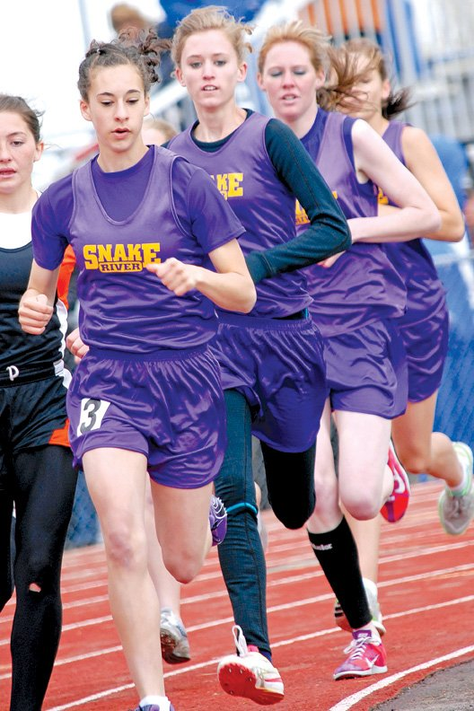 Shelby McKee leads a pack of Little Snake River teammates, including Delani Filip and Cora Foster, during the first lap of the 800-meter run during Friday's State Track and Field Championships in Casper, Wyo.