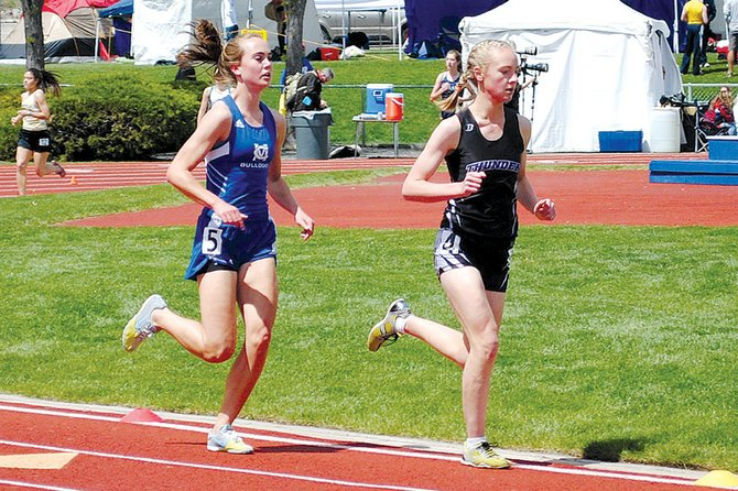 Maddy Jourgensen, left, competes in the 3,200-meter run Friday during the 4A state meet at Jeffco Stadium in Lakewood. The Moffat County High School senior took third in the race with a time of 11 minutes, 15.22 seconds. Jourgensen's time also beat out Christina Moyer's 1997 MCHS record of 11 minutes, 20.56 seconds.