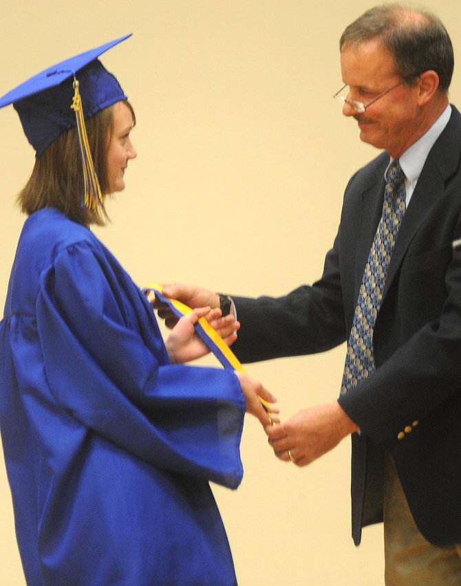 Kirsten Williams accepts a medal from school administrator Dave Entwistle for being Christian Heritage Schools valedictorian during Sundays graduation ceremony in Steamboat Springs.