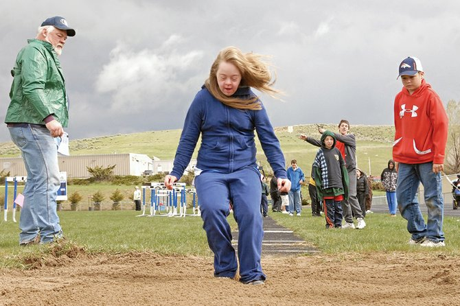 Special Olympics participant Ali Hamm from Olathe sticks the landing Saturday during a long jump event at Moffat County High School. Athletes from around the Western Slope took part in track and field, weightlifting and swimming events during the Special Olympics Colorado Western Area Summer Games.