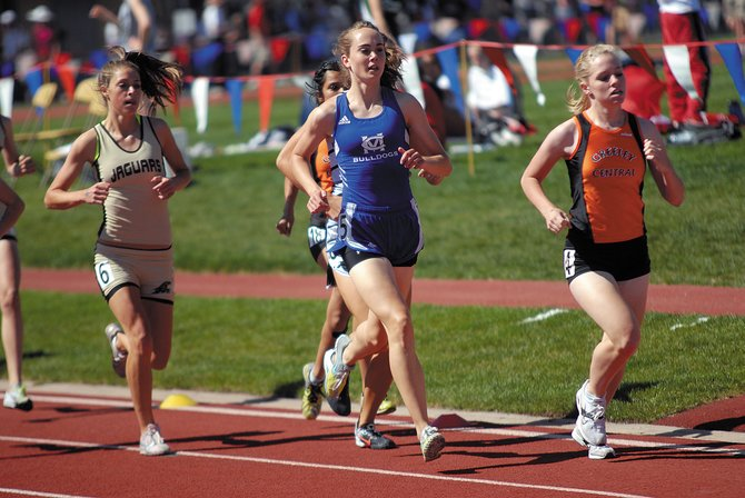 Maddy Jourgensen, center, runs in last year's state track and field meet at Jeffco Stadium in Lakewood. Jourgensen, a Moffat County High School senior, took fourth place in the 1,600-meter run at this year's 4A state meet.