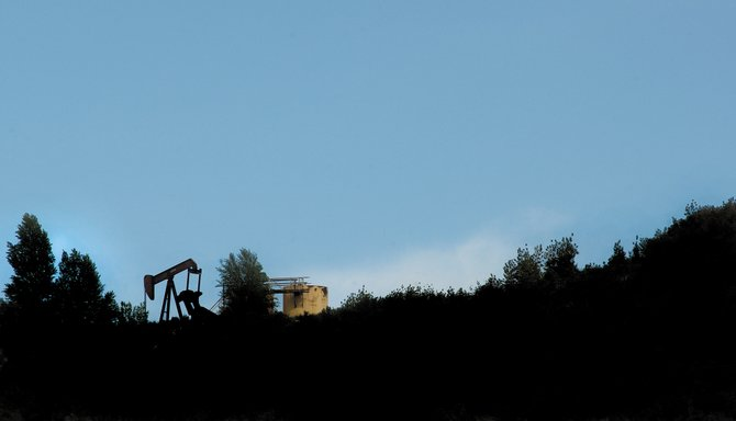 Oil extraction equipment is silhouetted on a ridgeline that runs alongside U.S. Highway 40 just outside of Milner in western Routt County. Routt County planner Chris Brookshire said three companies — Quicksilver Resources, based in Fort Worth, Texas; SWEPI, a subsidiary of Shell Oil; and True Oil, based in Casper, Wyo. — have inquired about the process in the past two months.