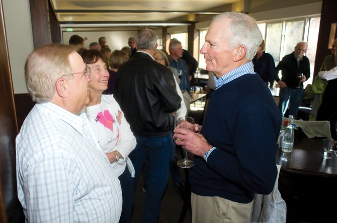 Joe Fogliano, right, visits with Bert Halberstadt and Susan Handloff at a happy hour for the Over The Hill Gang last week at Sweetwater Grill.