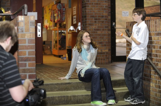 Shea Stanley, center, and Logan Scully, right, film a scene in April for the annual Steamboat Springs Middle School musical film production.
