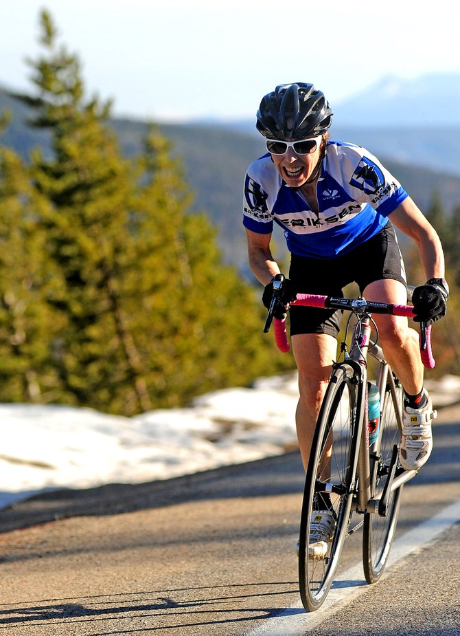 Tammy Jacques-Grewal charges up Rabbit Ears Pass on Wednesday. She finished third overall in the Rabbit Ears Time Trial near Steamboat Springs in 37:54.