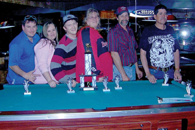 The Rock Out With Your Chalk Out pool team, pictured above, took first place in the Yampa Valley American Poolplayers Association championships May 21 and May 22 at Mathers Bar. From left are team members Chris Roberts, Tammy Shupp, Chris Katers, captain Val Tuthill, Paul Zywicki and Savino Corral. The team will play in the APA National Team Championships from Aug. 18 to 27 in Las Vegas.