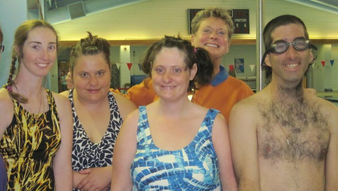 Rhianna Gifford, front row from left, Jaimee Sexton, Jamie Kaminski and Seth Sobeski celebrate after winning the 100-meter freestyle relay May 21 at the Craig Special Olympics.