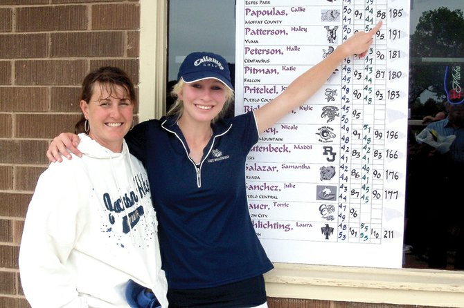 Callie Papoulas, right, stands with Ann Marie Roberts, the Moffat County High School girls varsity golf team head coach, Tuesday at Elmwood Golf Course in Pueblo. Papoulas, a MCHS senior, led the Bulldogs at the 4A state tournament, shooting a 185 over two days. Fellow senior Nike Cleverly shot a 198 and junior Samantha Fox shot a 206.