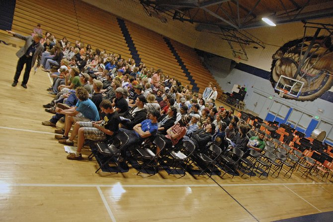 Moffat County High School principal Thom Schnellinger, far left, tells the Class of 2011 what to expect during graduation rehearsal Thursday in the gymnasium. At 10 a.m. Saturday at the high school, 900 Finley Lane, 136 seniors will walk the stage and turn their tassels.