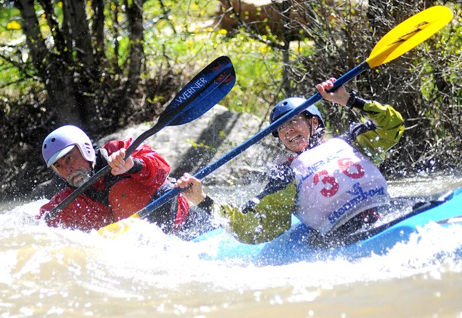 David Wallace and Betsy Frick carve a corner in their two-person kayak Sunday during the kayak rodeo event, part of the Yampa River Festival in Steamboat Springs. The festival wraps up today with the Paddling Life Pro Invitational.