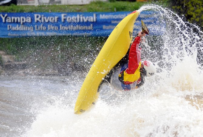 Nick Troutman flies through a trick Monday during the finals of the Paddling Life Pro Kayaking Invitational in Steamboat Springs. Troutman won the freestyle competition but lost the overall title as 17-year0old Dane Jackson, Troutman&#39;s brother-in-law, proved nearly as good on the freestyle wave a few seconds better in the morning&#39;s Fish Creek whitewater race.