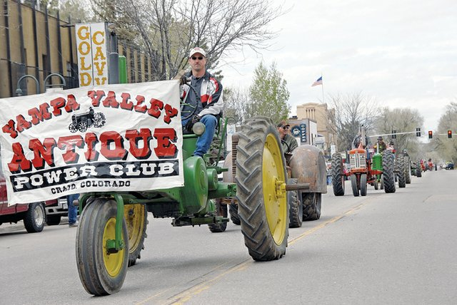 A line of antique tractors rolls down Yampa Avenue during the Grand Olde West Days parade Saturday. The tractors are part of the Yampa Valley Antique Power Club.