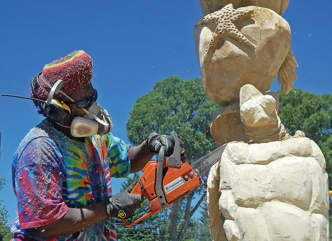 "Lafayette resident Bongo Love carves his sculpture, ""When We Are Together,"" during last year's Whittle the Wood Rendezvous. This year's event is slated for June 15 to 18 at Craig City Park, with a festival and concert by The Outlaws on the final day."