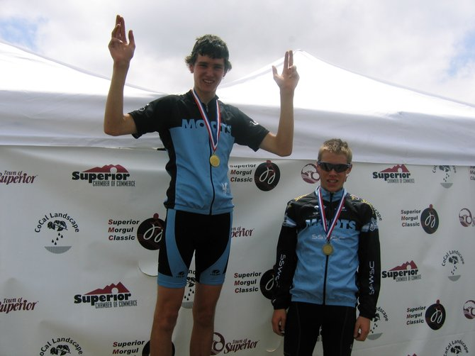 Steamboat Springs Winter Sports Club Cycling team members Evan Weinman, left, and Ben Berend celebrate after finishing the 2011 Morgul Bismarck Road Race in Superior on Monday. Weinman, despite a dropped chain, finished first with Berend in third.