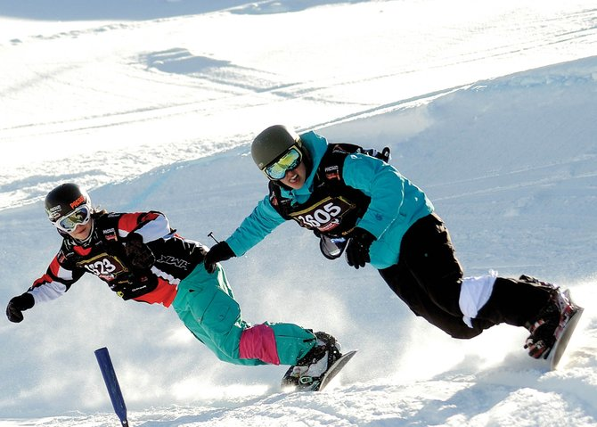 Chloe Banning, left, races teammate Jenna Feldman during a United States of American Snowboard Association snowboard cross event in Steamboat Springs. Banning wrapped up a banner year by solidifying her spot on the 2012 World Cup circuit.