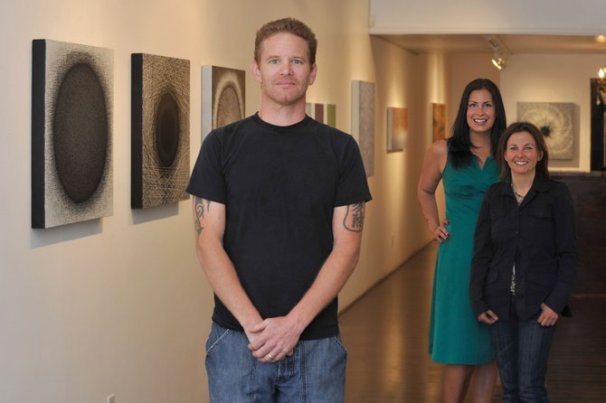 Artist Kenneth Ober will have his work featured this month at the K. Saari Gallery in a show curated by Kimberly Saari, back left, and Nancy Jeffrey. The show will end with a reception for the artist at 8 p.m. Friday.