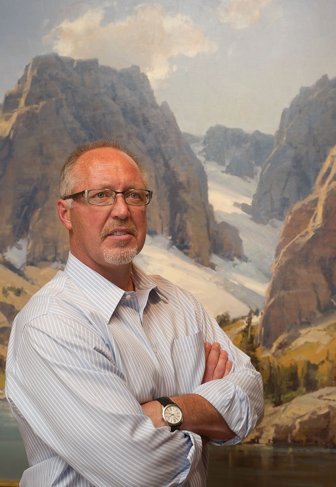 Landscape artist Scott Christensen stands in front of one of the large oil paintings depicting the scenic Wind River Range in Wyoming, which are on exhibit at the Steamboat Art Museum in Steamboat Springs.