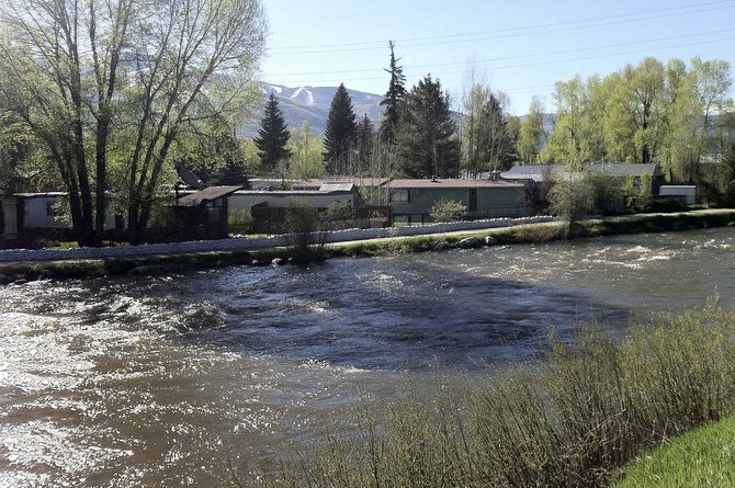 The Yampa River flows by Fish Creek Mobile Home Park on Thursday morning.