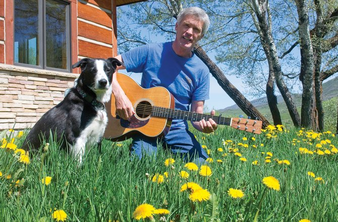 Tom Wood, and his dog Halle, hangs out in the front yard of his Fairview Home. Wood is releasing his first album after decades of performing. Wood, who has lived in Steamboat Springs since the early 1970s, is a regular local performer. He will perform with Sound Scoundrels at 8:30 p.m. today at Hahn's Peak Cafe.