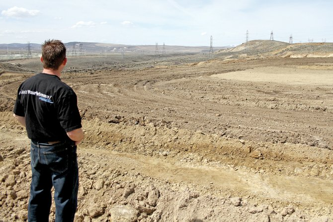 Gregg Kolbaba, a Craig native, overlooks the stock car track he is building in April at Thunder Ridge Motor Sports Park south of Craig. Kolbaba hoped to have the first stock car race on June 4, but wet weather pushed the opening day back to June 24.