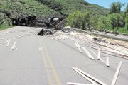 Lumber lies scattered Wednesday across Colorado Highway 13 after a single-vehicle crash south of Craig. Neither speed, drugs nor alcohol were factors, the Colorado State Patrol reported.
