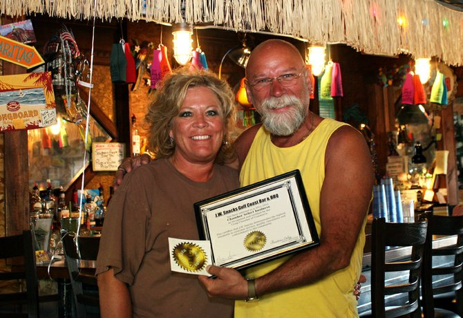 Teri, left, and Danny Griffith, owners of J.W. Snack's Bar & Grill, smile Thursday with the Chamber Select award presented to the restaurant. The Craig Chamber of Commerce Board selected the restaurant as the first recipient of the award for customer service, food quality, cleanliness and community involvement. The Chamber welcomes community nominations for future Chamber Select recipients.