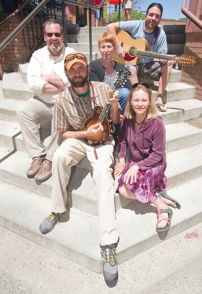 Old River Road is a new configuration of bluegrass musicians who will be playing a host of summer shows. The musicians, from top left, are Scott Kirton, Ann Kirton, Craig Thornhill, Carol Ives and Jason Striker. The band plays a show today from 6:30 to 8 p.m. at Steaming Bean Coffee Co.