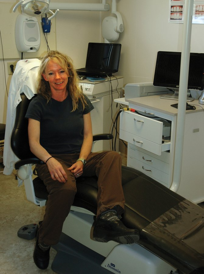 Tina Holliday, office manager of the South Routt Medical Center, sits in a dental hygienist's chair Tuesday at the clinic. In addition to a dental hygienist two days a week, the clinic will soon offer comprehensive dental care through the Northwest Colorado Dental Coalition from a recent $50,000 grant.