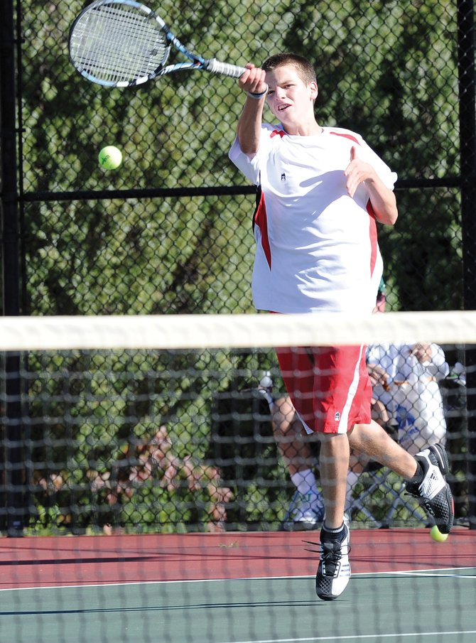 Jack Burger returns a shot during the opening day of the state high school tennis tournament in Pueblo. Burger was voted 2011 athlete male of the year by Steamboat Springs High School.