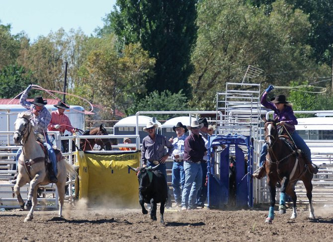 Ian Duzik, left, and Taylor Duzik participate in Moffat County High School's rodeo event in September 2010 at the Moffat County Fairgrounds. During the Colorado State High School Rodeo finals this Saturday and Sunday, Jed Moore, Colorado Northwestern Community College rodeo coach, will be on hand to recruit for CNCC's new rodeo team, which launches in the fall.