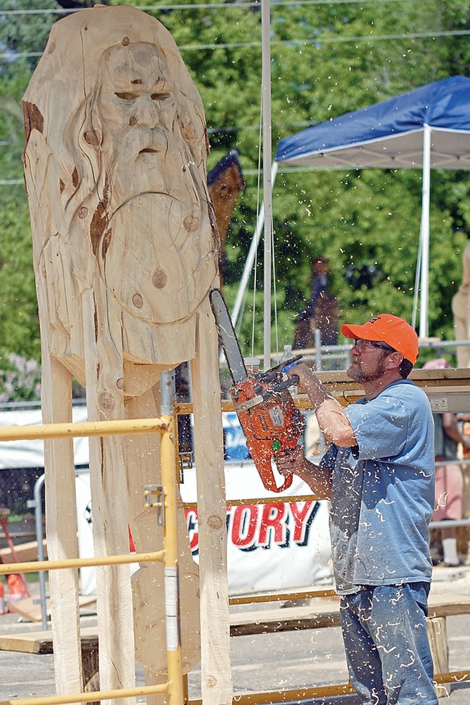 Canon City resident Sheldon Roberts sculpts Thursday during the Whittle the Wood Rendezvous at Craig City Park.