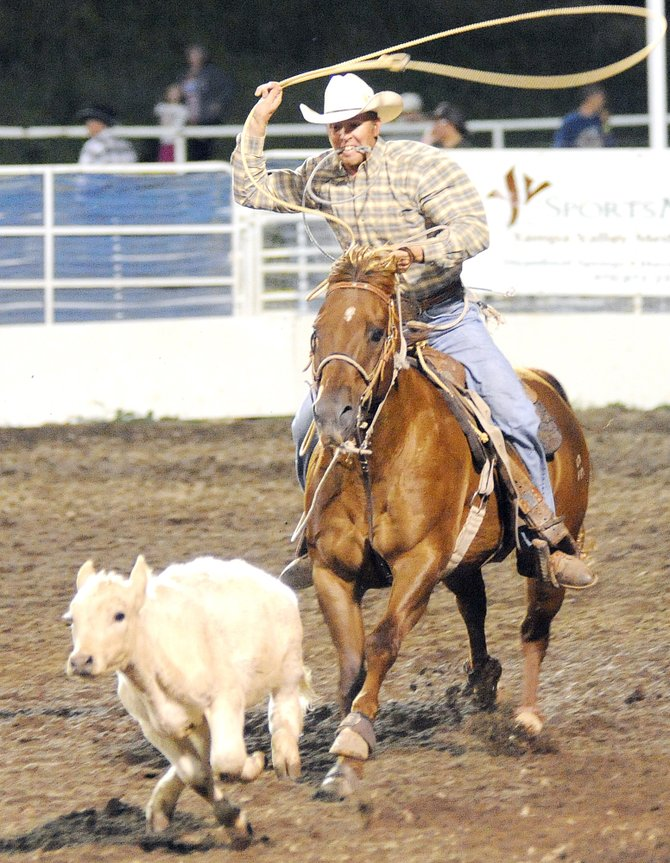 Coy Cummer swings for his calf during the tie-down roping event at a Steamboat Springs Pro Rodeo performance in downtown Steamboat. The rodeo returns to Steamboat tonight, the start of a 10-week stay in town.