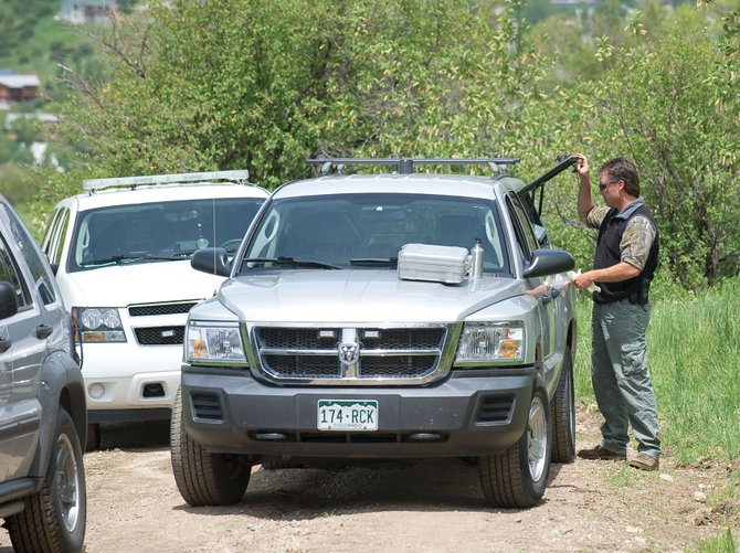 Nick Bosick, Steamboat Springs Police Department detective, investigates an unattended death on Emerald Mountain on Friday afternoon. Mountain bikers found the body of a man on singletrack trail between MGM and Blackmer Drive.