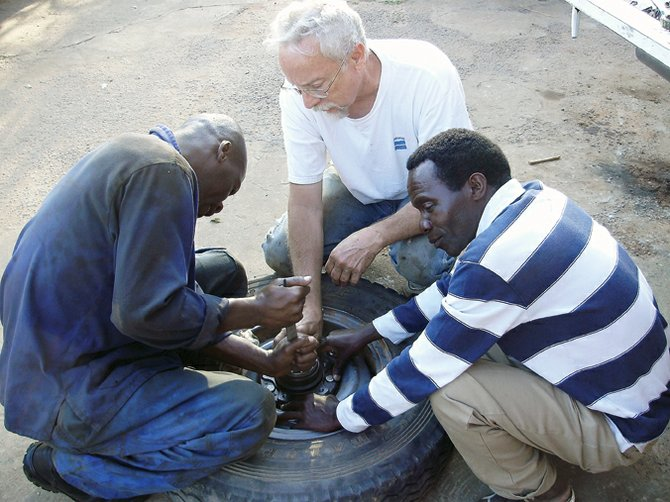 Former Craig resident Harvey Craft replaces a wheel bearing with fellow workers at the Marion Medical Mission Shallow Well Program in Malawi, Africa. Craft spent six weeks in Malawi last year providing maintenance to the program's truck fleet and installing pumps for water wells throughout the country. Craft will give a slideshow presentation at 6 p.m. Sunday at Calvary Baptist Church, 1050 Yampa Avenue.