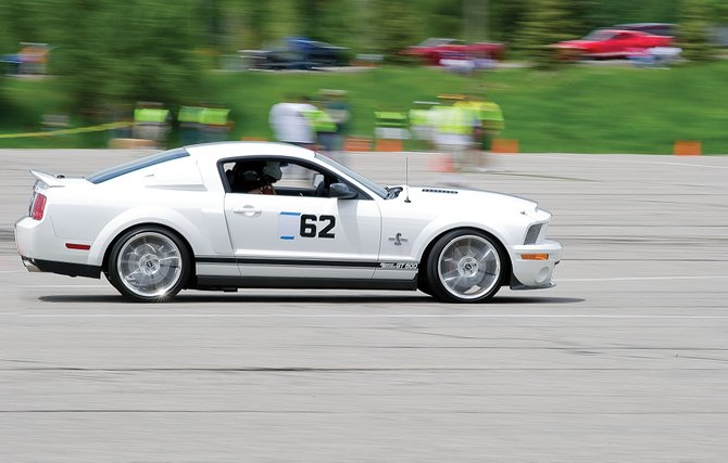 Michael Hood, of Denver, navigates a turn on the auto cross course at Meadows Parking Lot on Friday afternoon during the annual Rocky Mountain Mustang Roundup in Steamboat Springs. The Roundup will continue Saturday with the Show 'n' Shine from 10:30 a.m. until 3 p.m along Lincoln Avenue.