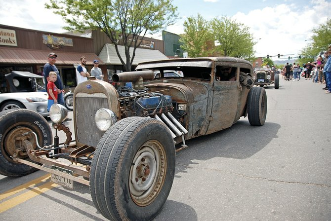 Hot rods prowl Yampa Avenue during the 2011 Bear River Young Life & Colorado Cruisers Car & Motorcycle Show on Saturday in Craig. The event was a fundraiser for Young Life, a Christian-based youth organization.