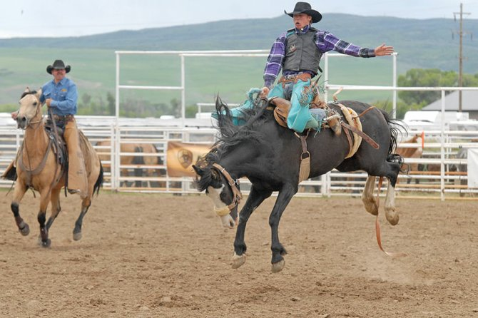 Garrett Buckley, a Moffat County High School rodeo athlete, competes in the saddle bronc riding championship round of the Colorado State High School Rodeo finals Sunday at the Moffat County Fairgrounds. Buckley won the championship round, and placed fourth overall. He will compete for the Colorado national rodeo team in July.
