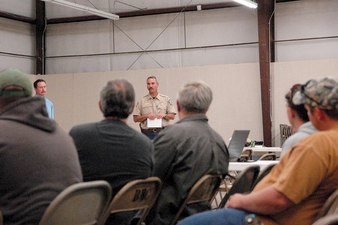 Bill de Vergie, a Colorado Division of Wildlife area manager, answers questions Monday night at the Rio Blanco County Fairgrounds during the DOW's meeting to discuss the decline in the White River deer herd. DOW managers and biologists discussed the affects of habitats and predators on deer herds.