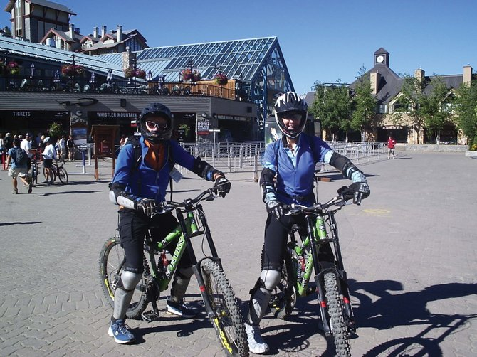 Steamboat Springs resident Johanna Hall and her husband sport their rented downhill bikes and protective gear during a trip to Whistler, British Columbia. The Steamboat Ski Area is in the early stages of constructing a downhill biking area on Mount Werner.
