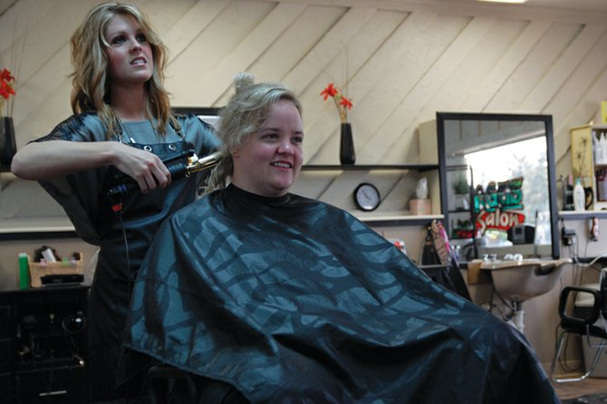 Kelsey Bauman combs and curls customer Morgan Cobb's hair at New Images Hair Salon, 337 W. Victory Way. Bauman has been a professional stylist for five years and previously worked with famous stylist Nicholas French in Denver before coming back to her hometown of Craig.