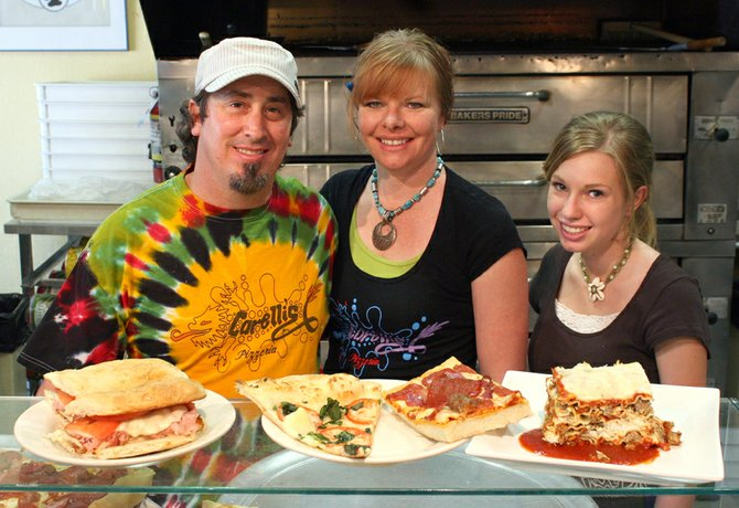 "Craig Daily Press readers voted Carelli's Pizzeria & Pasta, 465 Yampa Ave., as the restaurant with Moffat County's best sandwich, best pizza and best Italian food. Pictured, from left, are co-owners Brett Etzler and his fiancée, Stephanie Perez, and waitress Jasmine Higgins. The food, from left, is the D.C. (or Dick Cheney) sandwich, margarita pizza, Sicilian-style widow-maker pizza and sausage lasagna. Perez said the keys to the restaurant's success are good recipes passed on from the previous owners, as well as handmade and fresh, not frozen, ingredients. ""It's a lot of labor and a lot of prep, but, man, it's so worth it,"" Perez said."