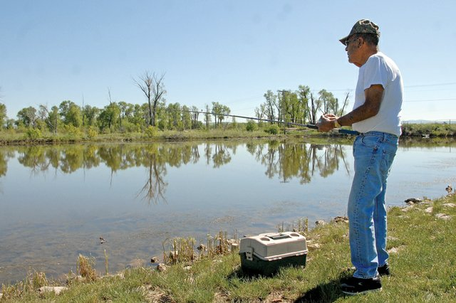 Joe Archuleta, 71, fishes in the pond Wednesday at Loudy-Simpson Park. Craig was recently ranked 77th in Outdoor Life magazine's fourth annual rankings of the top 200 towns for sportsmen. Archuleta, a Craig resident, said he tries to make it to Loudy-Simpson at least once a week to enjoy the outdoors.
