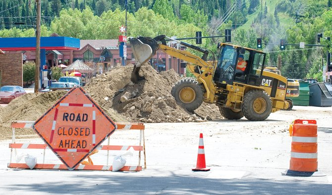 A front-end loader dumps dirt into a pile on Seventh Street on Friday afternoon. Construction crews continued to work on the sewer line in the ally between Seventh and Eighth streets in downtown Steamboat Springs.