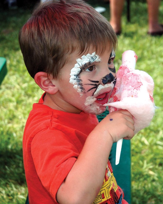 Bryan Vandenburg, 3, indulges in a sugary treat at the 14th annual Taste of South Routt on Saturday in Oak Creek. Organizers with the South Routt Economic Development Council said 600 people attended the event throughout the day.