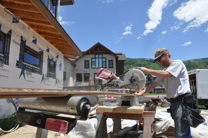 Michael Wiley cuts trim Thursday for a home on Snowflake Circle. Routt County's construction industry accounted for several of the jobs that have been lost since 2008 because of the recession.