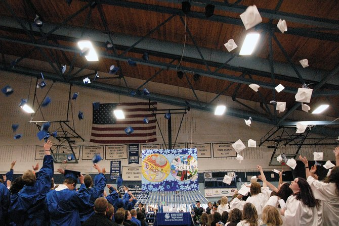 Mortarboards fly May 28 in the Moffat County High School gymnasium at the conclusion of the graduation ceremony. In recent years, the number of students who haven't made it to graduation has improved, a trend school officials are hoping to see continue.