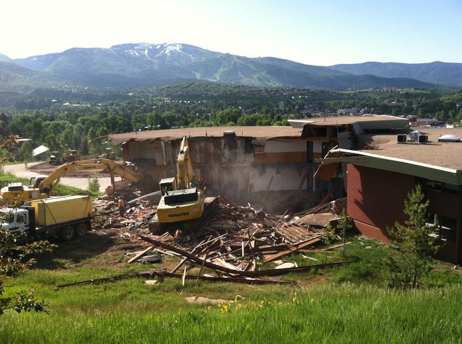Construction crews begin the demolition of CMC's Monson Hall on Monday, June 27, 2011.