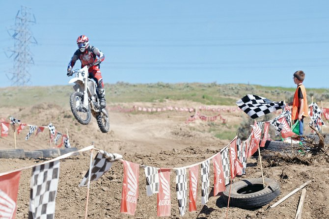 A motocross racer catches air Sunday at Thunder Ridge Motor Sports Park finish line. Sunday marked the second event at the newly established track. Attendance was low, but track owner Gregg Kolbaba remains optimistic about the development's future.